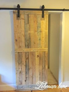 A pallet sliding barn door adds a lot of character, saves space, looks amazing, and is cheap and easy to make. Learn how to build it and build yours today! #diy #palletideas