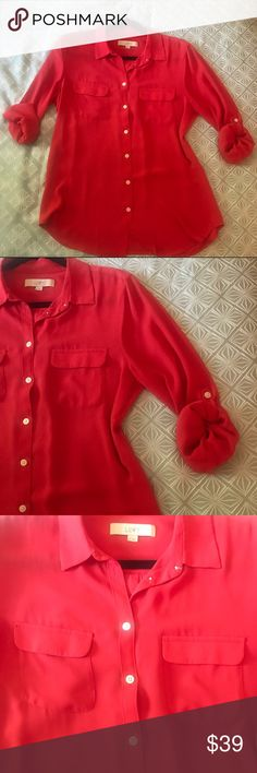 Cherry Tomato Red LOFT Utility Button Up Blouse M Classic Cherry Tomato Red LOFT Utility Button Down Blouse Medium. Such a bright vivid red, perfect for when you need a pick me up or an extra dose of confidence. In great previously owned condition. Roll tab sleeves for a long sleeve or short sleeve look. The red is a cross between cherry red and tomato red. Beautiful even on a redhead. Silky flowy material. Top blouse. LOFT Tops Button Down Shirts