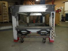 Heavy welding bench, with scissor jacks moving retractable wheels. ingenuity!     Welding Table - WeldingWeb™ - Welding forum for pros and enthusiasts