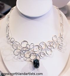 Handmade sterling silver wire and lampworked glass bead necklace by Susan Pauls. (sold)
