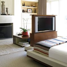 Pop-up tv cabinet in walnut with integrated bench & upholstered bed. Talking Tables coffee table in background in Oriental wood & lacquer. Pop Up Tv Cabinet, Tv Cabinet Design, Tv Wall Cabinets, Tv Furniture, Tv In Bedroom, Luxury Rooms, Upholstered Bench, Apartment Living, Interior Design