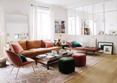 leather and velvet in a spacious white living room | a happy chic parisian apartment tour via coco kelley