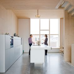 MAATworks wooden townhouse in Amsterdam, low open kitchen