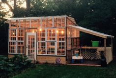 Greenhouse built from 45 old windows from all different places. Some bought most donated. Wanted to keep the shabby chic, vintage look so added Mason jars lights with Edison bulbs inside. The owner/builders Eric and Elizabeth love garden veggies and wanted to be able to do it year round, and threw in flowers for pops of color. No plan, just started building and this is what it became. Lincolnton, NC.