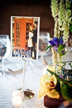 Name your wedding tables after cities you have visited together, and make table cards using photos from your trip! | 'where are you?' greece, centre parcs lalala