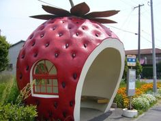 """Fruit bus Stop / Isahaya.Japan /It was built in """"Konagai-cho"""" in is a bus stop of the form of the fruit of all the 5 kind This is a Strawberry bus stop Nagasaki, Bus Stop Design, Bus Stand, Bus Shelters, Pumpkin Carriage, Eco Architecture, Amazing Architecture, Roadside Attractions, Roadside Signs"""