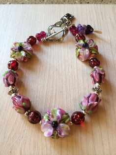 Raspberry and Pink Floral Lampwork Bracelet by NorthWestTradingCo