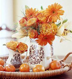 centre de table avec fleurs et clémentines