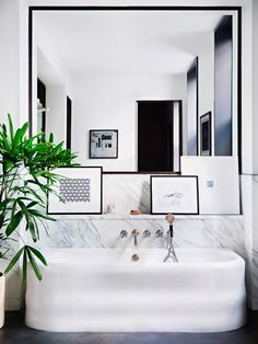If a view of the New York skyline is not within your budget, a wall-to-wall mirror can do the trick—creating a sense of vastness while keeping the intimacy desired in a small...