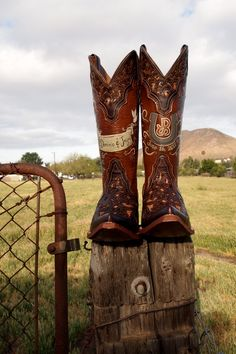 Wedding boots- she rodeos & he's a farmer. Custom painted by Hopscotch Dandelions