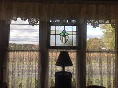 Stain glass window purchased at The Elegant Attic in Buxton NC