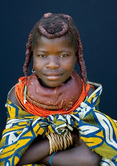 Africa | Mwila girl - Angola.  Mwila (or Mumuhuila, or Muhuila) women are famous for their very special hairstyles. Hairstyles are very important and meaningful in Mwila culture. Women coat their hair with a red paste called, oncula, which is made of crushed red stone. They also put a mix of oil, crushed tree bark, dried cow dung and herbs on their hair. Besides they decorate their hairstyle with beads, cauri shells (real or plastic ones) and even dried food. | Image and caption © Eric…