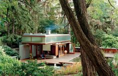 I think I could love this house in the woods.  Little artsy, lots of light.