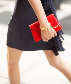 Alexander Wang dress, fringes, Maiyet bracelets, Valextra clutch / Garance Doré