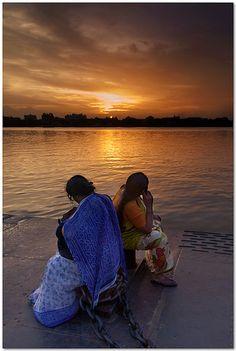 Watching the sun set . Ganges
