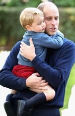 Prince George gives his famous dad a hug. Picture: Chris Jackson/Getty Images