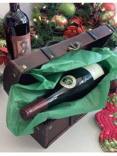 Wooden Wine Gift Box - A memorable way to present wine or spirits! The Wooden Wine Gift Box is sturdier than a flimsy bag...and when you add a bottle, it's like giving (or getting) two gifts in one. Solutions.com