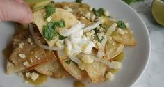 Mexican Chilaquiles are tortilla chips packed with flavor - a lighter alternative to nachos Easy Chilaquiles Recipe, Chicken Chilaquiles, Verde Sauce, Mexican Cheese, Mexican Food Recipes, Ethnic Recipes, Enchilada Sauce, Tortilla Chips, Roasted Vegetables