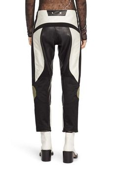 """Motorcross-inspired patchwork crop pant100% Cotton main fabrication100% Contrast cotton sateen combos throughout100% Contrast sheep leather combos throughoutSnap closure at waistband with zip flyFunctional stretch kneeFully linedModel is 5'9"""" wearing size 2"""