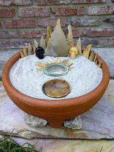 Indoor/Outdoor Fire Garden or Altar. I love the idea of this to create some kind of portable altar that can represent Earth, Air, Fire, and Water all together.