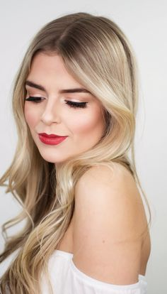 Blonde with bold brows, cat eye, and red lips