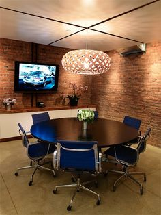 CONFERENCE ROOM-- really like the lighting on the brick walls; blue chairs, black table, light floors