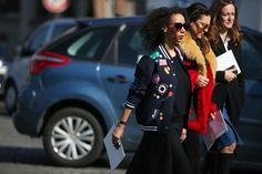 84 Outfit Ideas For Style Extroverts #refinery29  http://www.refinery29.com/2015/03/83675/paris-fashion-week-2015-street-style#slide-57  Cartoonish stickers give a basic varsity jacket a new outlook.Mira Mikati jacket.
