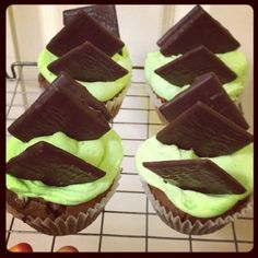 Mint Choc chip cupcake with mint green frosting topped with an After Eight