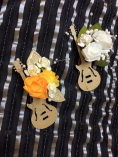 Music themed best men & groom boutonnieres with roses Music Wedding Cakes, Guitar Wedding, Groom Boutonniere, Boutonnieres, Wedding Stuff, Wedding Flowers, Wedding Ideas, Wedding Decorations, Table Decorations