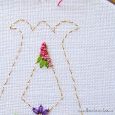 Voided Monogram with Floral Background with many links on how to do different stitches
