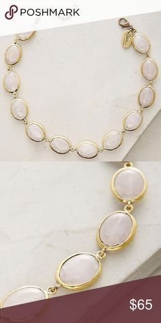 """Anthropologie Skipping Stones Choker Necklace NWT This beautiful necklace has a shade of light rose pink color and it's semi-transparent. When facing light, you can see the textures inside the stone, very cool touch. The chain/extender and metal trim of the stones are brass and adds more depths and sophistication to the necklace. Very cool looking.   13""""L+2""""extender. Anthropologie Jewelry Necklaces"""