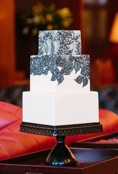 Brides.com: . The Butter End Cakery created dramatic black lace (all made from sugar!) that was added to the rolled-chocolate-covered tiers to match the pattern found on the couple's wedding invitation.   Starting from $12 per slice, The Butter End Cakery