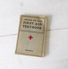 First Aid Textbook // Medical Book // Red Cross // Halloween Decoration // Vintage Books // Science Book // Gift under 20 Old First Aid Textbook // Medical Book // Red Cross // Halloween Decoration // Vintage Books // Scie Red Cross First Aid, Karin Uzumaki, Will Solace, Science Books, Science Textbook, American Red Cross, Vintage Medical, Vintage Books, Vintage Library