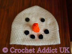 Ravelry: Christmas Snowman Beanie Hat 1 yr+ pattern by Crochet AddictUK Crochet Christmas Hats, Crochet Snowman, Crochet Kids Hats, All Free Crochet, Crochet Beanie, Cute Crochet, Knit Hats, Crochet Football, Beanie Pattern