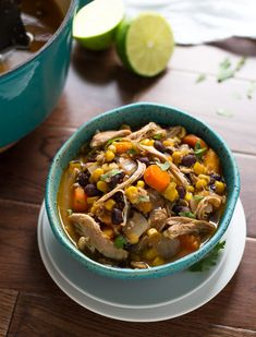 Slow cooker chicken stew.Chicken thighs with salsa and vegetables cooked in slow cooker.
