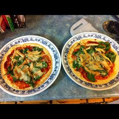 **MADE THESE - Tortilla Pizzas...Take a tortilla, cover in pizza sauce (I took tomato paste and added in some spices) add toppings...pictured is spinach, leftover chicken from a baked chicken and a tad of Parmesan cheese!**
