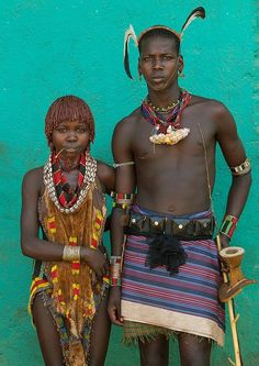 Photo of husband and wife in traditional clothes. Omo Valley Tribe, Ethiopia, Africa