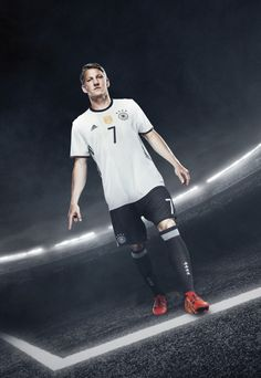 The new Adidas Germany Euro 2016 Home Kit returns to black shorts, while also featuring new positioning for the iconic Adidas 3 Stripes. The spectacular new Germany 2016 Away Jersey is reversible. Mario Gomez, Fifa 2014 World Cup, German National Team, Bastian Schweinsteiger, German Boys, Uefa Euro 2016, World Cup Winners, European Championships, Football Kits