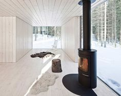 This winter home in Virrat, Finland, is designed by Helsinki studio Avanto Architects. The house with four wings called Four Cornered Villa has beautiful views over the surrounding landscape.