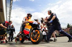 Casey Stoner on a Repsol Honda race bike
