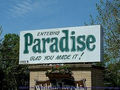 https://flic.kr/p/4SRGm5 | Funny Sign - Paradise | Welcome to Paradise! They even have a sign when you get there. It's in the Upper Peninsula, tucked up there by Lake Superior.