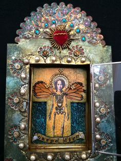 Laurie Mika-tin and glass shrine