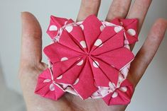 The Crafty Cupboard: Fabric Flower Origami  http://craftycupboard.blogspot.com/2010/11/fabric-flower-origami.html