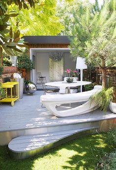 Outdoor deck.  Love that little step