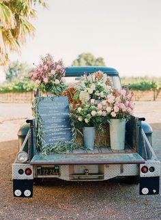 This is the perfect display for a menu or program at a rustic outdoor wedding. I love the hay bales and huge bunches of flora; not to mention the old truck! Sheer perfection!