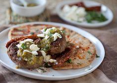 Spiced #Moroccan #Burgers with Green #Harissa, Feta and Mint over Grilled Pita | The Artful Gourmet