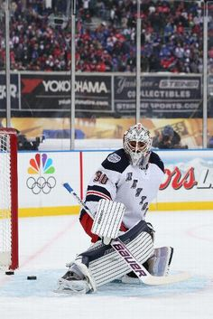 Henrik Lundqvist #30 of the New York Rangers warms up