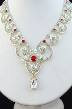 The Queen Mother's Necklace. Originally belonging to Queen Victoria, this piece was eventually handed down as a gift to Queen Elizabeth II. While the weight of the prestigious Necklace has never been officially revealed, it is known to have around 45 large diamonds within it. #RoyalJewels #AntiqueJewelry