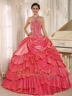 Halter Watermelon Red Pleat 2013 Quinceanera Dress With Beaded Bodice In Tarija City  http://www.facebook.com/quinceaneradress.fashionos.us  http://www.youtube.com/user/fashionoscom?feature=mhee   Get a celebrity look for less with this stunning halter top watermelon ball gown dress! The top has a keyhole like shape before around the neck. The full skirt has several tiers of organza fabric which is made in neat pleats just like a accordion.