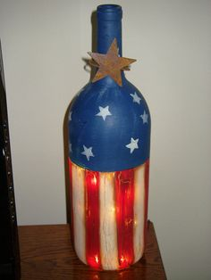 Lighted Patriotic Wine Bottle by SandysPaintinPlace on Etsy, $16.00...I would like to have the bottom cut off to use with a candle outside